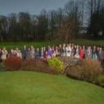 wedding at Uphall Golf Club image of bridal party with guests standing on bridge