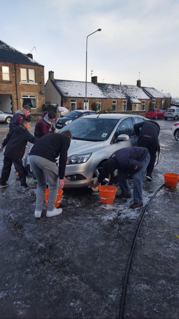 Uphall golf club juniors washing cars