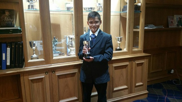 Owen with 2 trophies