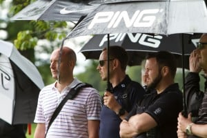 A couple of former champion's watch on in the rain