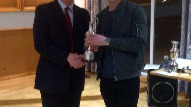 Jack Cummings receives the Championship Trophy